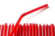 Row Of Red Plastic Straws With...
