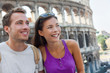 Happy tourists couple in Rome Italy. Europe travel vacation young forreign students on summer holiday smiling portrait. Asian girl, Caucasian man.