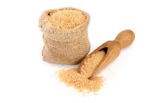 Brown Sugar In Wooden Scoop An...