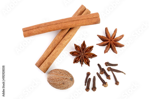 Fototapeta Cinnamon sticks with star anise, nutmeg and clove isolated on white background. Top view obraz