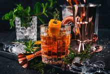 Alcohol Cocktail Negroni. Orange, Liquor, Ice. On A Black Wooden Background.