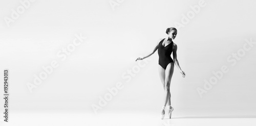 Graceful ballerina dancing in art performance Poster Mural XXL