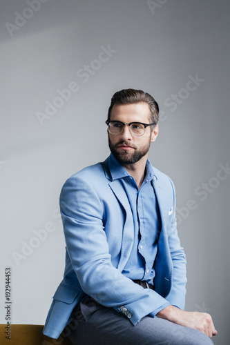 Fototapety, obrazy: stylish bearded man in glasses and blue trendy suit