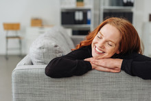 Young Redhead Woman Reliving H...