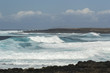 Rough turquoise sea with big waves and surf at La Santa, Lanzarote, Canary Islands, Spain