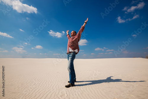 Fototapety, obrazy: Joyful tourist, man is enjoying traveling in the desert