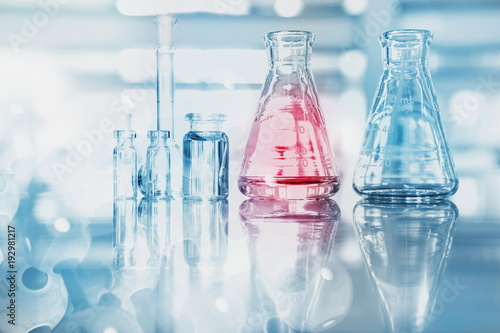 Fotografie, Obraz  blue red glass flask vial and chemical structure in research medical science tec