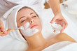 canvas print picture - Woman in mask on face in spa beauty salon.