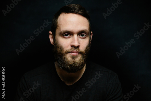 Handsome man portrait looking into a camera