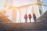 Fototapeta Na drzwi - Rear view of business team climbing stairs go to a city. Business concept