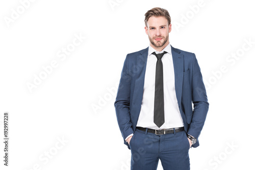 Fotografia portrait of caucasian businessman in suit with hands in pockets isolated on whit