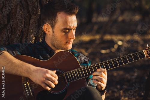 Man playing guitar in nature