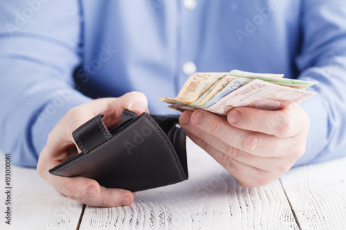Fototapeta Hands taking out money from wallet obraz