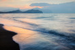 Picturesque seascape on beauty seacost. Sandy beach and blurred waves glowing by sunrice light. Vacations travel concept