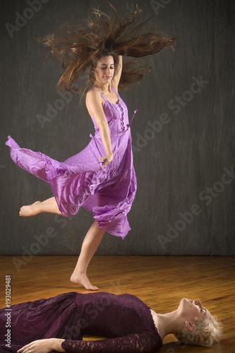 Photo  Two young women dancing on hardwood floor in the studio.