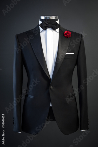 Fotografie, Obraz Tailored suit, tuxedo isolated on black background on mannequin