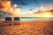 Sunrise, beach chairs on the tropical carribean beach.