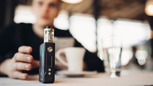 Using Electronic Cigarette To Smoke In Public Places.Smoke Restriction,smoking Ban.Using Vaping Device With Flavoured Liquid.E-juice Vaping New Technology.Give Up Tobacco.Smoking Habit,nicotine Addict