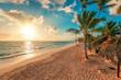 Summer vacation in Punta Cana. Beautiful sunrise over tropical island beach.