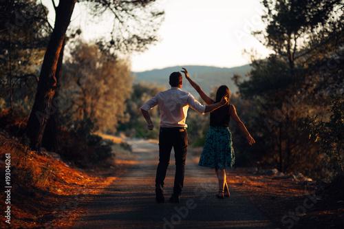 Fotografie, Obraz  Romantic couple dancing on the street