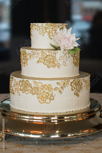 3 Tier Wedding Cake With Gold Embroidery And A Single Edible White