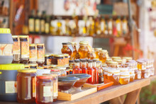 Honey In Glass Jars And Bottles On The Counter. Selling Delicious And Healthy Product.