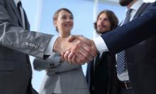 Welcome And Handshake Business...