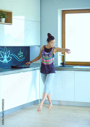 Fotografie, Tablou Fit and attractive young woman preparing healthy meal. Woman.