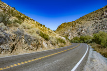 Highway Road Cutting Through The Mountains In The Anza Borrego Desert