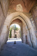 gate in turret of Alcantara bridge, landmark and monument from ancient arab age, in Toledo city, Spain, Europe. Vertical