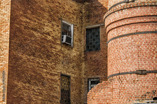 Staande foto Industrial geb. Old industrial building. Old factory. Old architecture. Building fragment. Brick factory. Brick walls