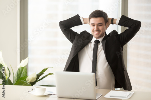 Happy Smiling Businessman Looking At Laptop Screen While