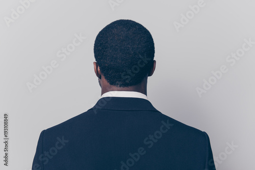 Valokuva  Rear, back side view portrait, snap shot of attractive, trendy man with modern h