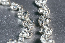 Silver Necklace With Diamonds Close-up On A Grey Background