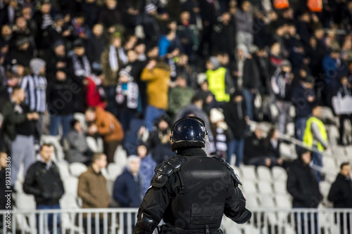 Fényképezés  The police at the stadium event secure a safe match against the hooligans