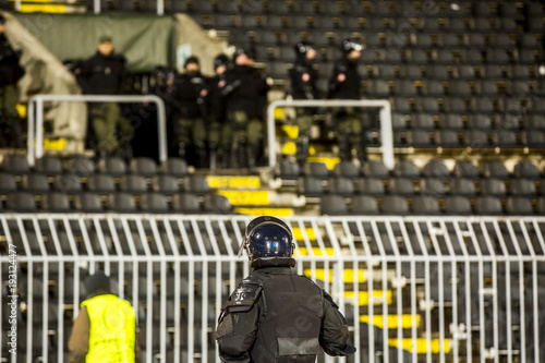 Vászonkép  The police at the stadium event secure a safe match against the hooligans