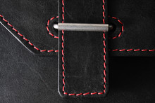 Black Leather Stitched With Red Thread