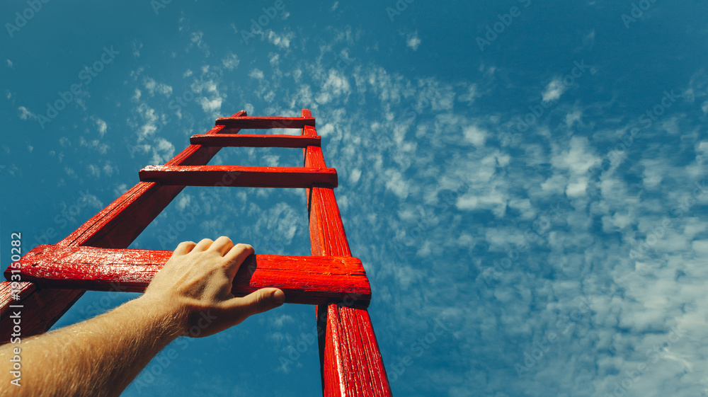 Fototapety, obrazy: Development Attainment Motivation Career Growth Concept. Mans Hand Reaching For Red Ladder Leading To A Blue Sky