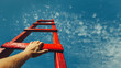 canvas print picture - Development Attainment Motivation Career Growth Concept. Mans Hand Reaching For Red Ladder Leading To A Blue Sky