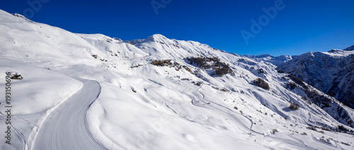 Panoramic view of the slopes of Orcieres-Merlette ski resort in Winter. Hautes-Alpes, Ecrins National Park, Champsaur, Alps, France