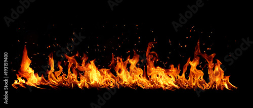 Blazing flames over black background Tableau sur Toile