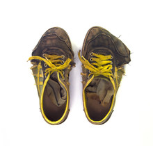 Dirty Sneakers Isolated On Whi...