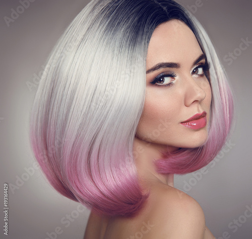 Fototapety, obrazy: Colored Ombre bob hair extensions. Beauty makeup. Attractive Model Girl blonde with short pink hairstyle isolated on gray background. Closeup woman portrait.