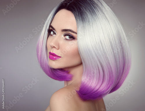 Fototapety, obrazy: Bob hairstyle. Colored Ombre hair extensions. Beauty Model Girl blonde with short purple hair style isolated on gray background. Closeup woman portrait.