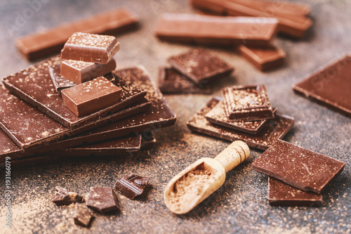 Tuinposter Koekjes Chocolate bar pieces. Background with chocolate. Sweet food photo concept. The chunks of broken chocolate