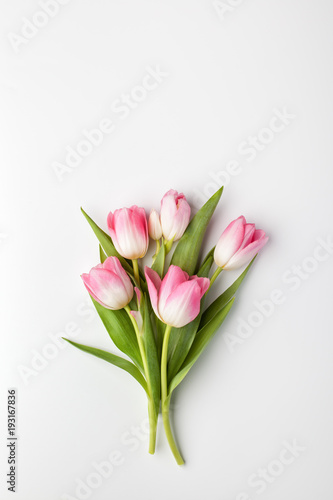 Pink tulip flowers bouquet on white background. Flat lay, top view. #193167836