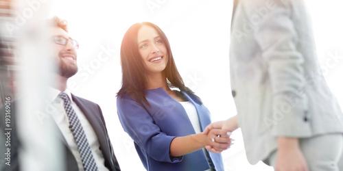 Businesswomen Shaking Hands In Modern Office Canvas Print