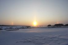 Sunset In Winter. False Sun, Rainbow, Halo Effect