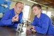 Two engineers looking at metal apparatus