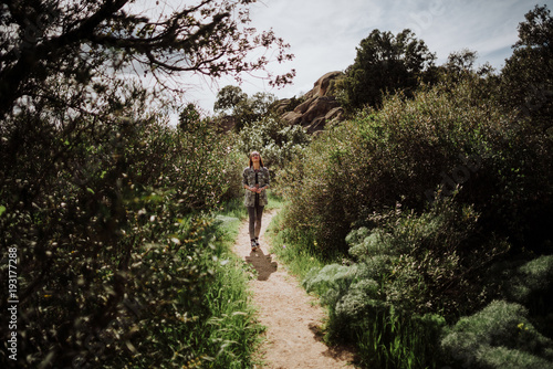 Attractive woman on path in nature